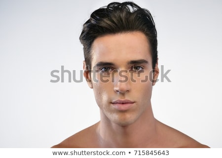 Close up portrait of a handsome man combing Stock photo © deandrobot
