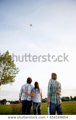 2 couples watching balloons rise in sky Stock photo © IS2