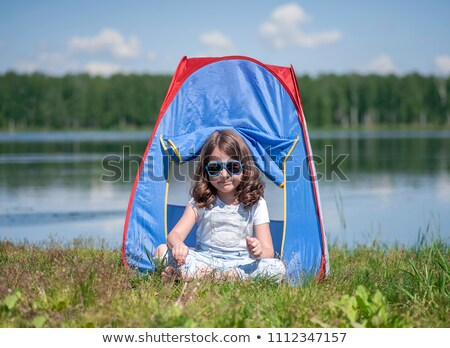 Children sitting in tent at campsite Stock photo © IS2