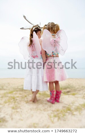 Rear view of girl at beach with feather Stock photo © IS2