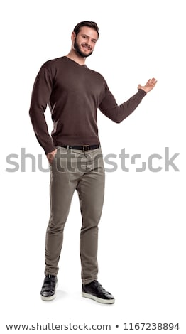 smiling businessman with hand in pocket presenting something stock photo © feedough