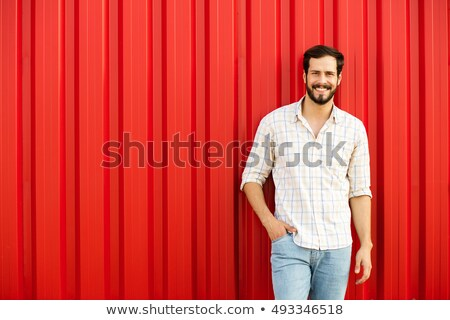 portrait of handsome relaxed man with red checkers shirt Stock photo © feedough