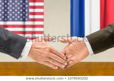 Representatives of the USA and France shake hands Stock photo © Zerbor