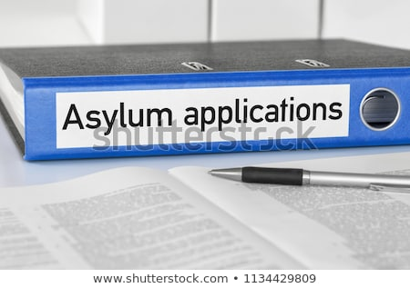 A blue folder with the label Asylum applications Stock photo © Zerbor