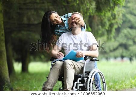 Сток-фото: женщину · глядя · отец · сидят · коляске · счастливым