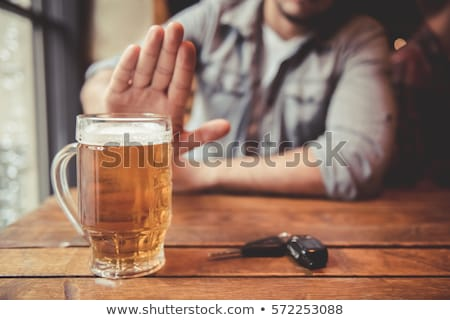 man drinking beer and driving car stock photo © makyzz