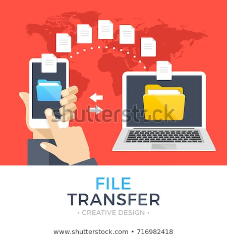 File transfer. Hand holding smartphone with folder on screen and documents transferred to computer.  Stock photo © makyzz