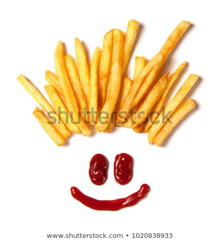 Hair from potatoes, French fries and a face with a smile from ketchup isolated on white background stock photo © FreeProd