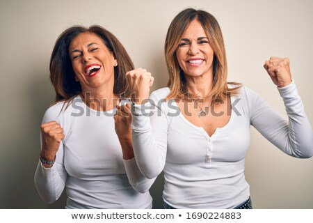 happy middle age woman in white t-shirt Stock photo © dolgachov