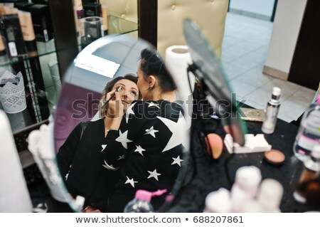 Pretty, young woman having her hair done Stock photo © lightpoet