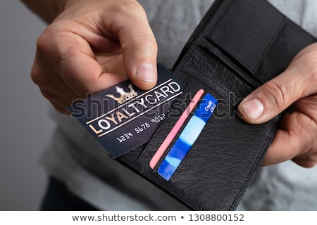 Person Removing Loyalty Card From Wallet Stock photo © AndreyPopov