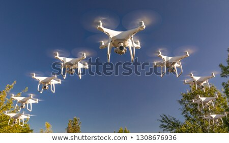 Formation of Drones Swarm in the Blue Sky Stock photo © feverpitch