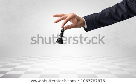Big hand taking his next step on chess game Stock photo © ra2studio