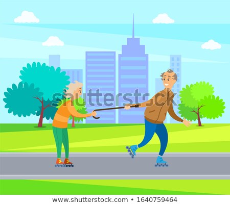 Old People Having Fun in Park, Man and Woman Rolling Stock photo © robuart
