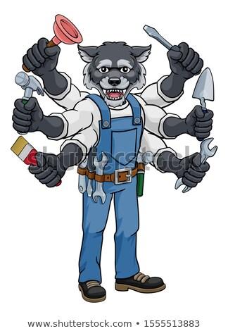 Wolf Multitasking Handyman Holding Tools Stock photo © Krisdog
