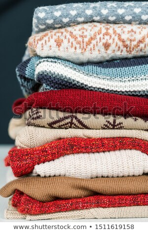 stack of new woolen and cotton sweaters and jumpers prepared for cold days stock photo © pressmaster