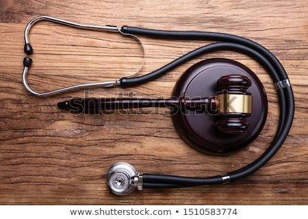Gavel With Stethoscope Arranged On Table Stock photo © AndreyPopov