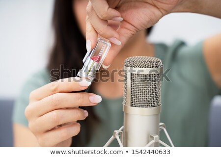 Woman Opening Lipstick On Microphone To Make Asmr Sounds Stock photo © AndreyPopov
