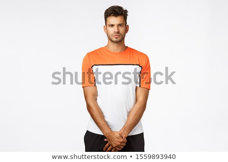 Serious-looking football player standing in wall during free-kick penalty area, look determined and  Stock photo © benzoix