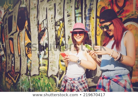 smiling red haired teenage girl in sunglasses Stock photo © dolgachov