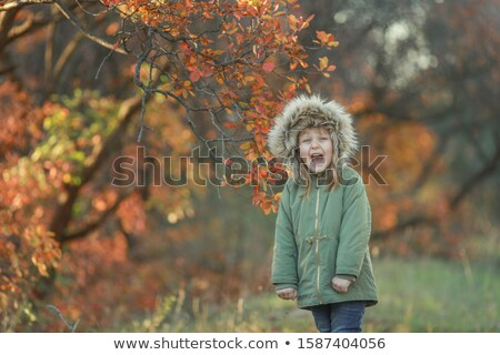Baby girl alone while walking on a cold Sunny October day Stock photo © ElenaBatkova