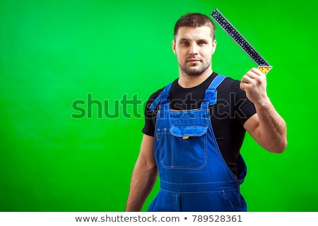 Young tradesman holding a try square Stock photo © photography33