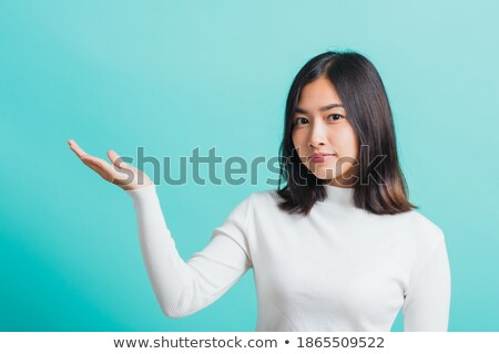 Businesswoman demonstrating blank copy area Stock photo © christinerose81