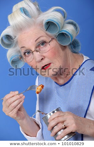 funny grandmother eating canned food with fork Stock photo © photography33