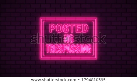 No trespassing on a cement wall Stock photo © jeremywhat