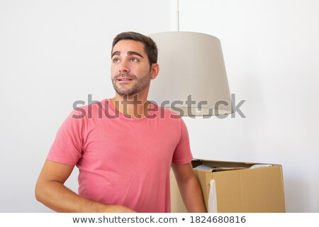 man looking for his things in box stock photo © pzaxe