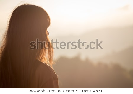 Beautiful female over sunset Stock photo © Anna_Om