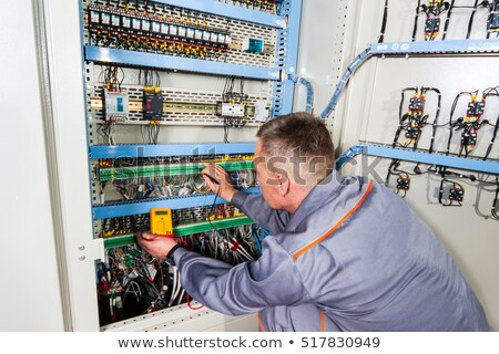 Electrician inspecting fuse box Stock photo © photography33