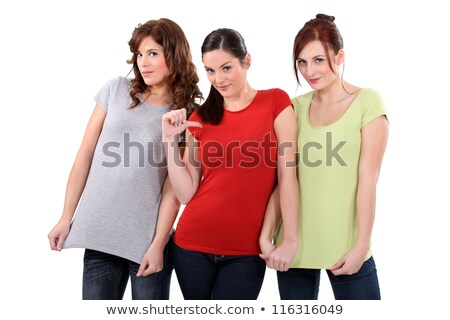 two women showing their t shirts one woman pointing finger toward herself stock photo © photography33