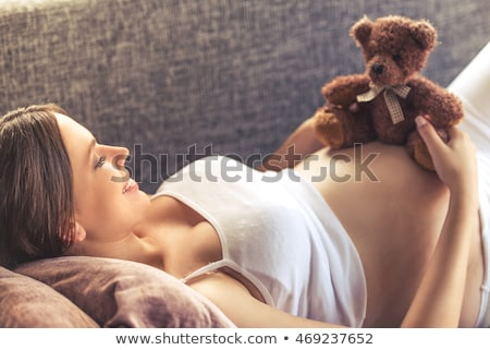 Pregnant woman with teddy bear Stock photo © photography33