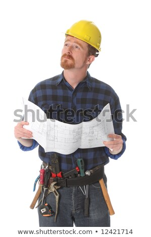 tradesman looking at a blueprint stock photo © photography33