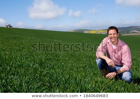 Farmer kneeling by crop Stock photo © photography33