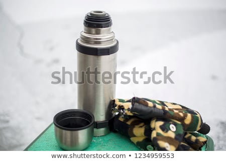 Beautiful girl with a flask and a cigarette stock photo © acidgrey