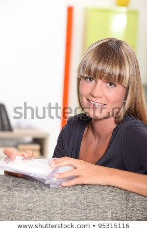 A teenager sorting her Cds. Stock photo © photography33