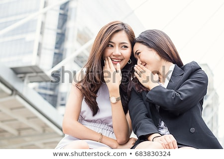 mixed race woman whispering secrets outside stock photo © feverpitch