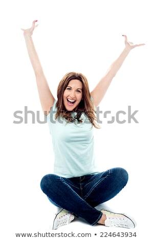 csinos · nő · ülő · padló · kezek · izolált · fehér - stock fotó © stockyimages