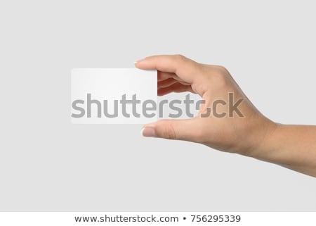 Női kéz tart névjegy izolált fény Stock fotó © grasycho