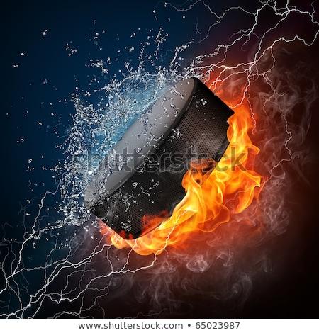 Hockey puck in fire flames and splashing water Stock photo © Kesu