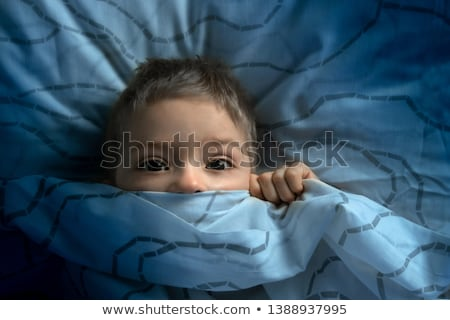 Kid in bed, afraid of the darkness Stock photo © curvabezier