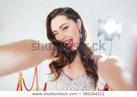 красный ковер улыбка портрет красивой глядя Сток-фото © eldadcarin