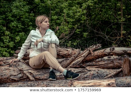 portrait of young beautiful woman on stump Stock photo © Aikon