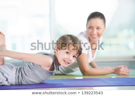 Healthy morning stretching - woman with son doing gymnastic exer stock photo © HASLOO
