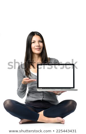pretty girl presenting brand new laptop stock photo © stockyimages
