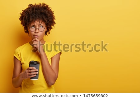 woman holding spectacles and thinking stock photo © stockyimages