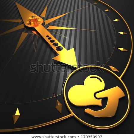 Gouden icon hart hand kompas zwarte Stockfoto © tashatuvango