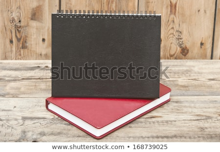 desk calendar with red leather note book on wood table stock photo © inxti